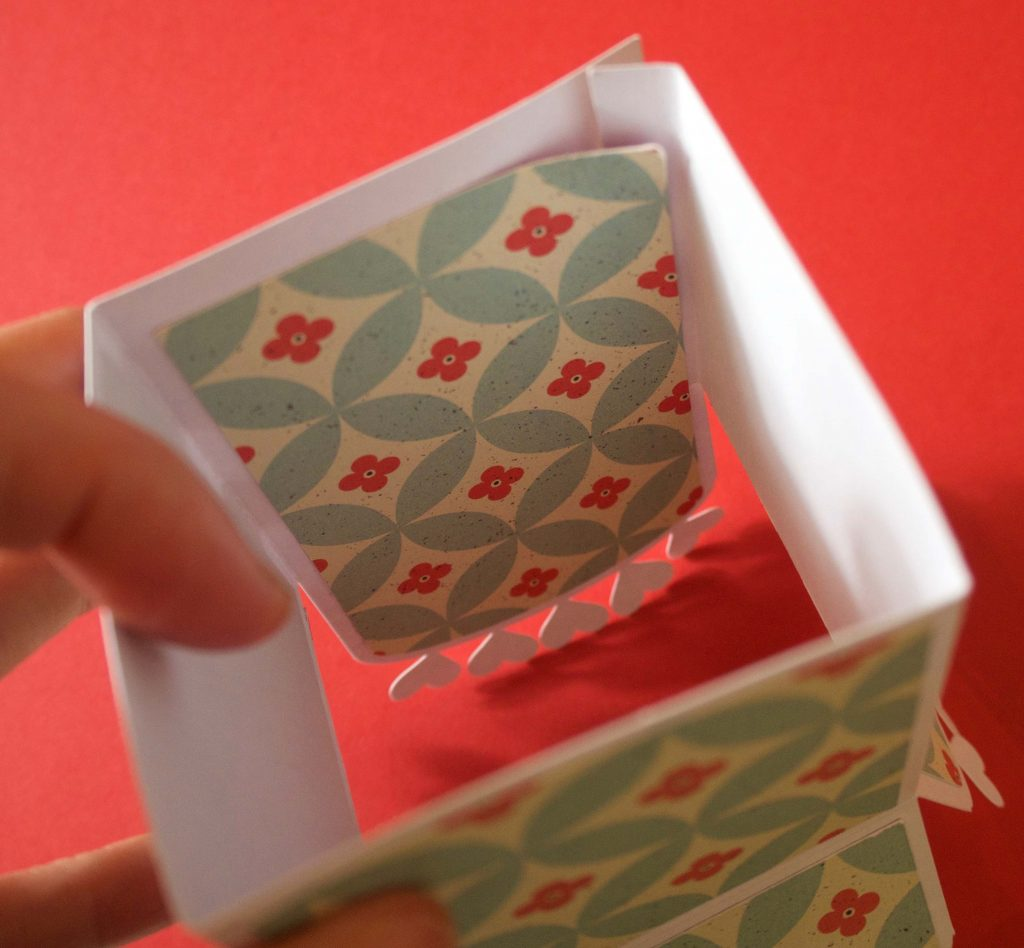 Assembling the box shape of a pop-up card