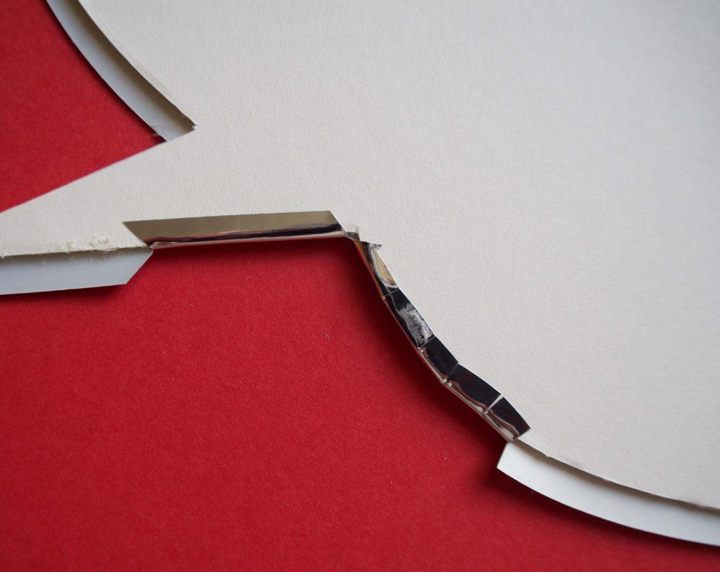 Overlaying silver vinyl onto mountboard