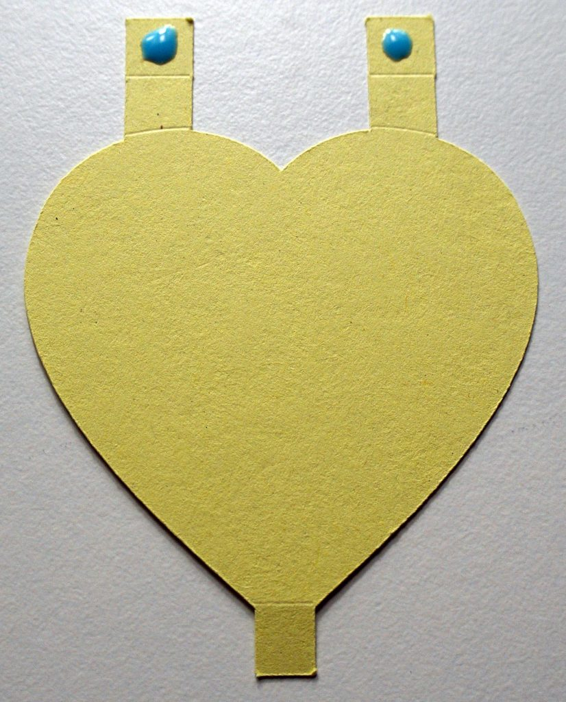 Cricut heart cut-out with glue applied