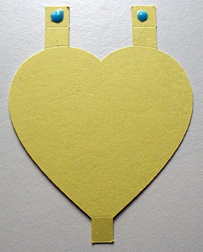 Cricut heart cut-out with glue applied