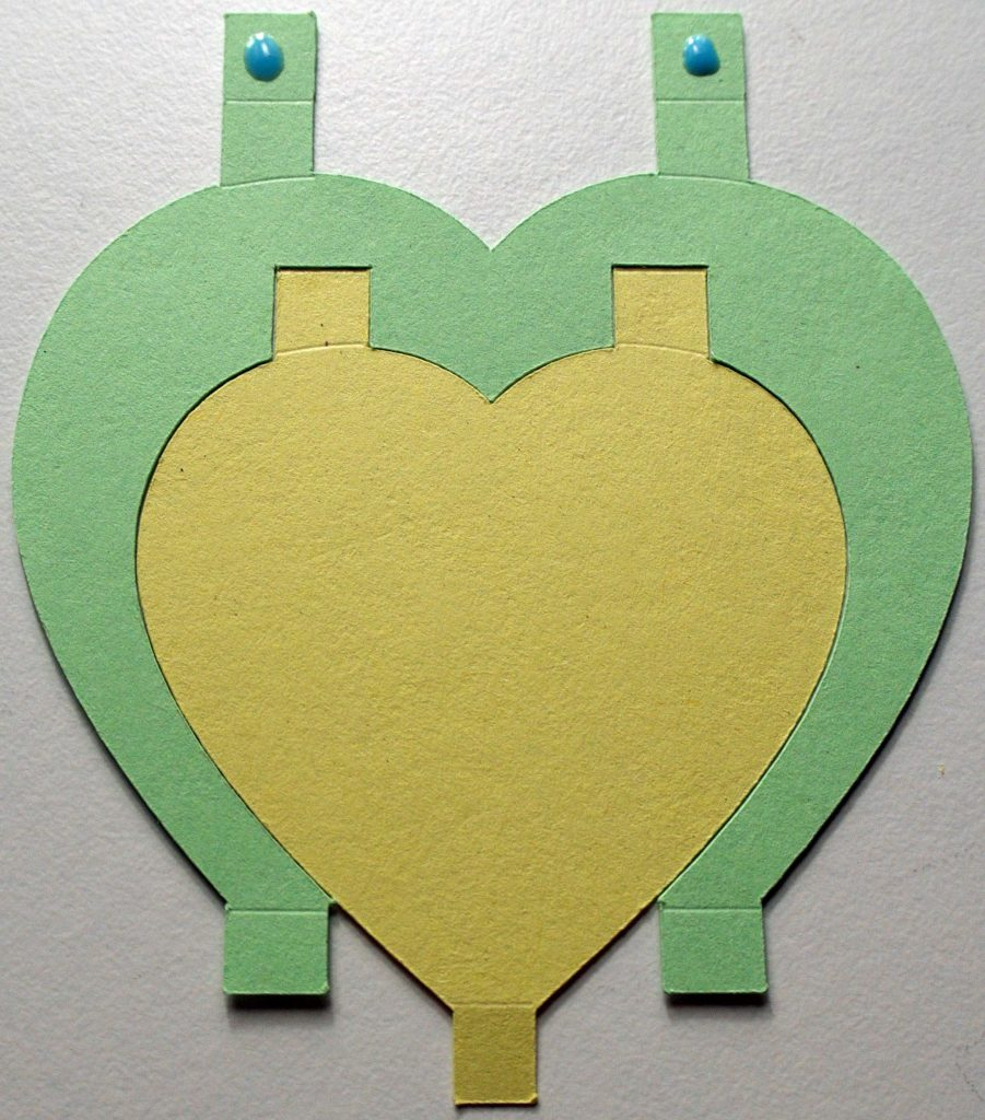 Joining together heart-shaped Cricut-cut paper pieces