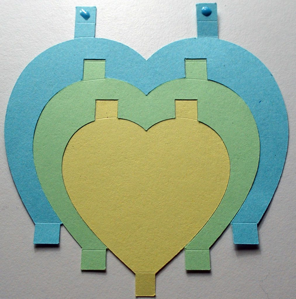Gluing together Cricut-cut heart pieces