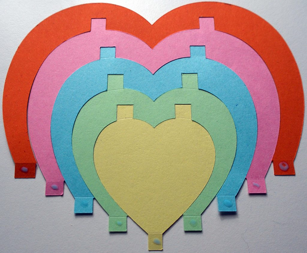 Five Cricut-cut concentric paper hearts glued together