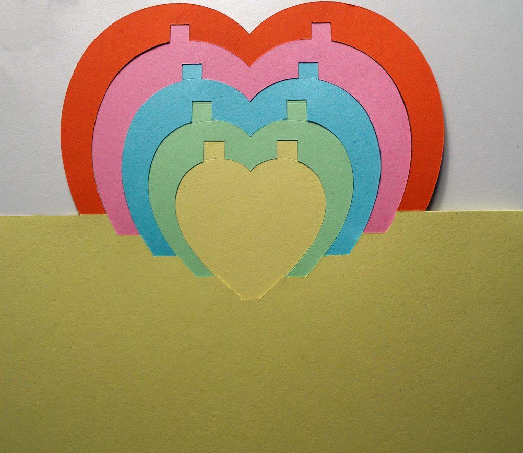 Half a Cricut-cut birthday card with hearts
