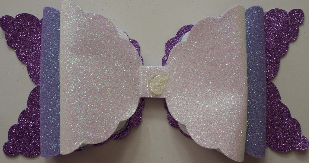 Triple glitter bow assembly