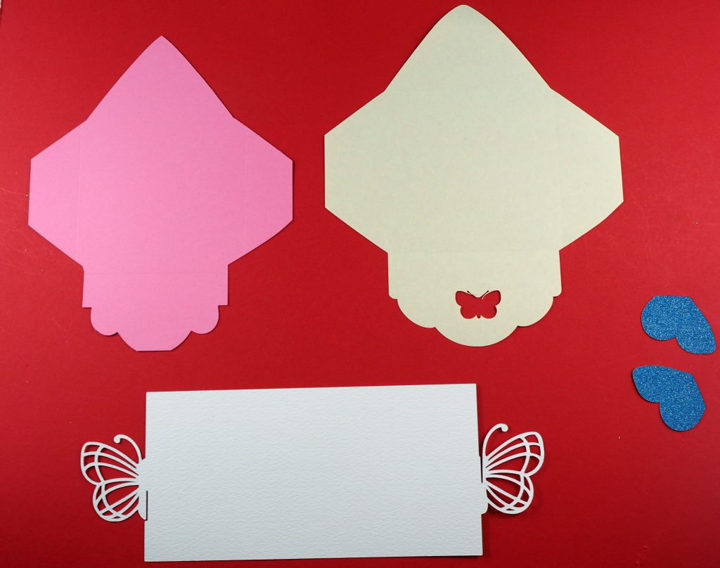 Pieces to assemble a Wedding Invitation Made on the Cricut