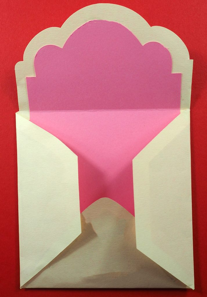 Gluing a wedding invitation envelope together