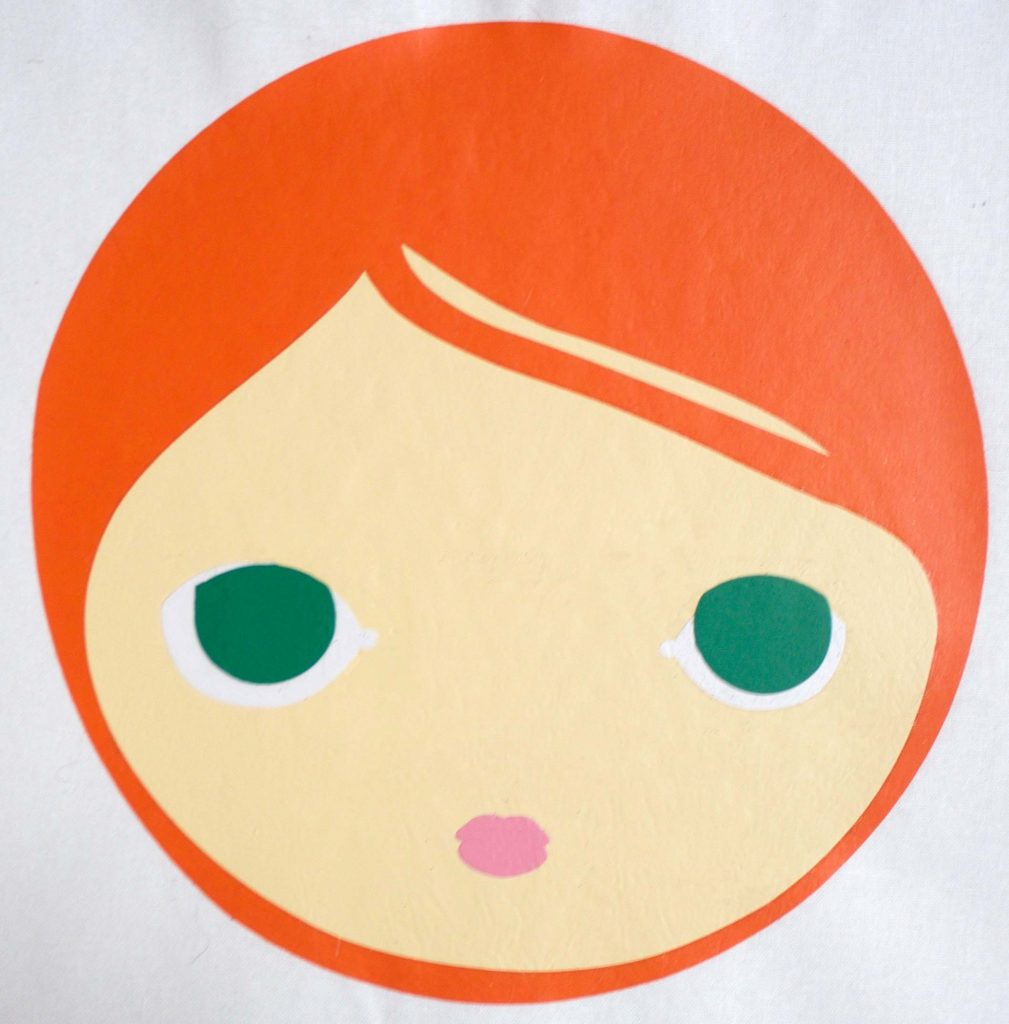 Putting together pieces of retro Mod face on Tote bag with htv