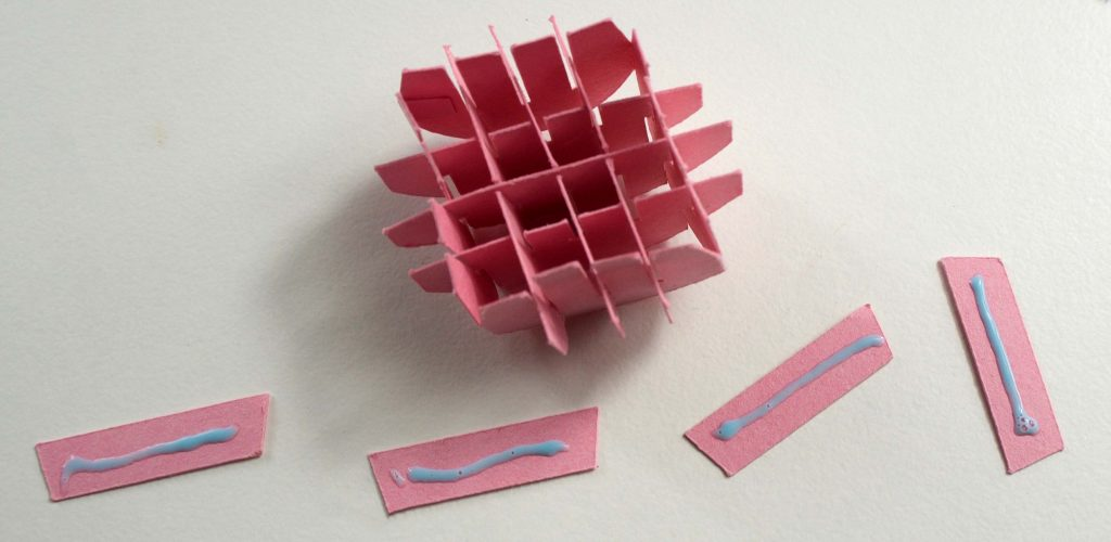 Gluing pop-up pieces for flower card