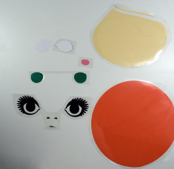 Pieces of Mod girl face tote bag cut on Cricut