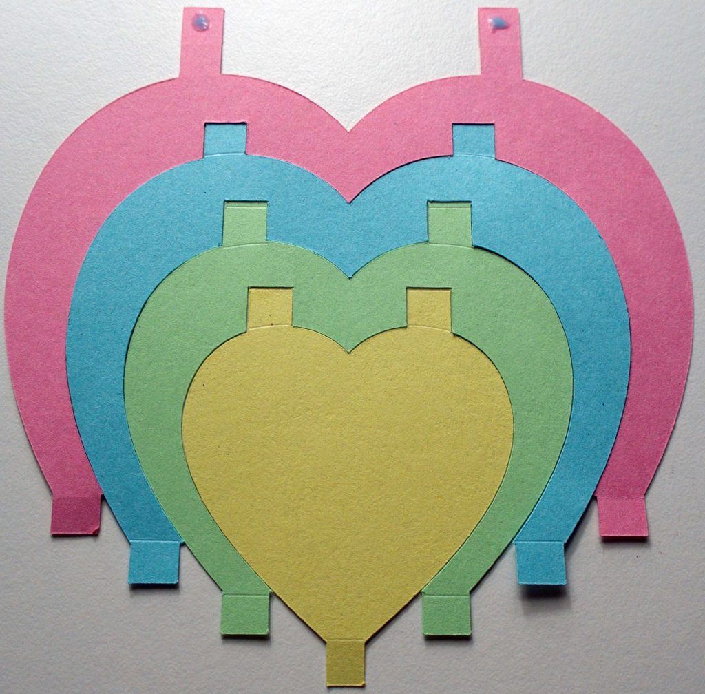 Gluing Cricut-cut hearts together