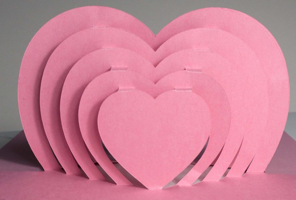 Pink concentric pop-up hearts on the Cricut