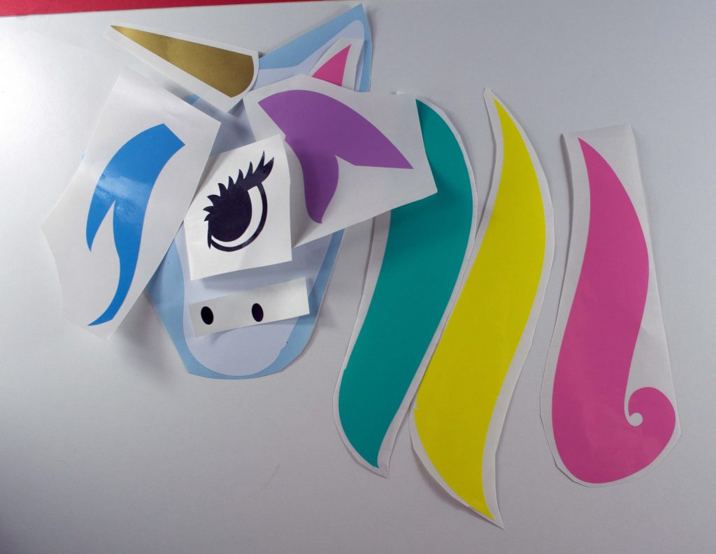 Colourful pieces of vinyl to assemble a unicorn
