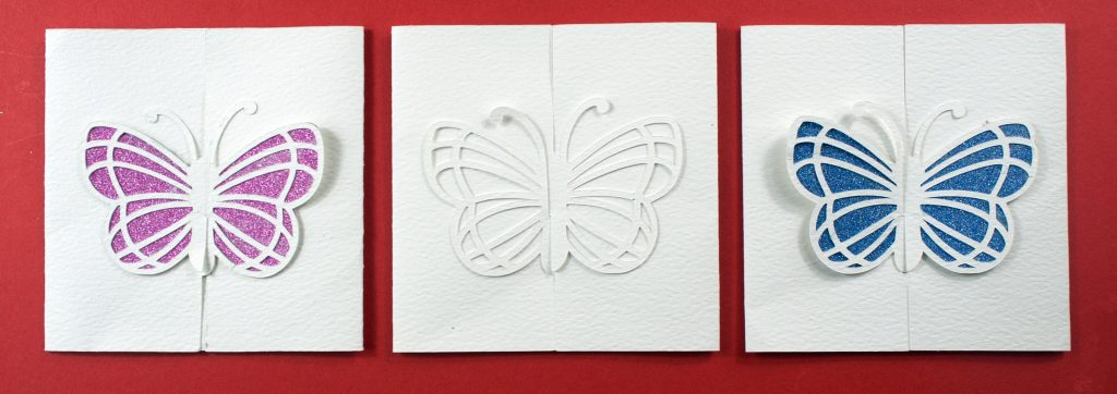 Butterfly wedding invitations in different colours
