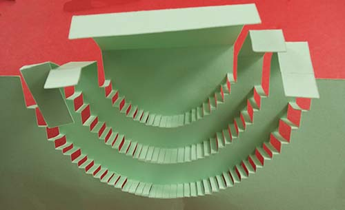 Folded score lines on pop up cake card