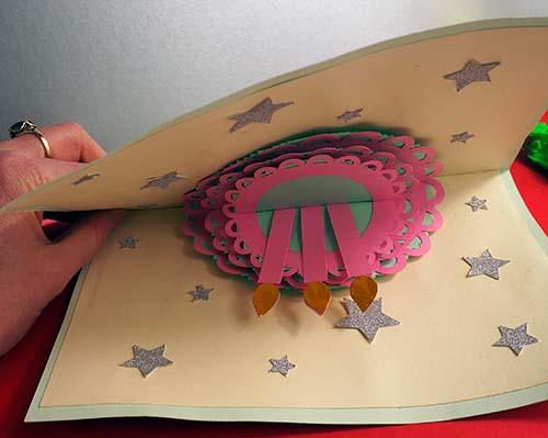 Closing a pop up cake card