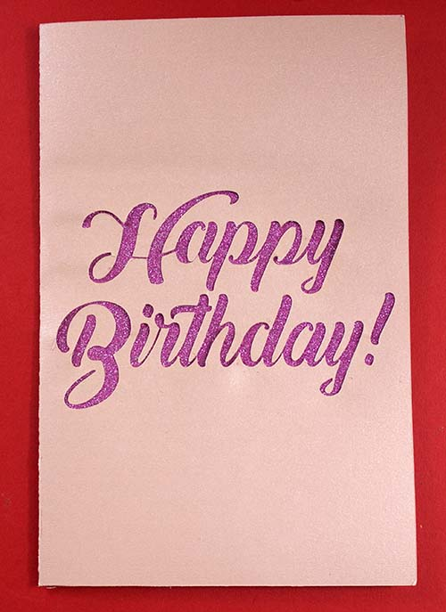 Glitter front of pop-up birthday card