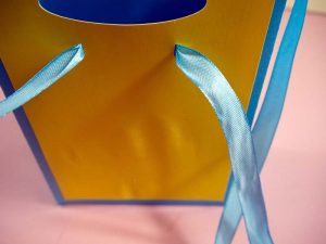Threading ribbon through gift bag - Cricut cut file