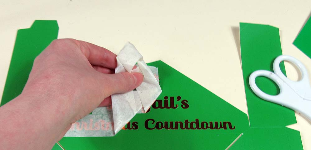 Peeling tape from personalised advent calendar