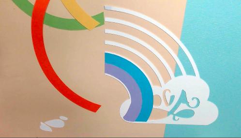 Two rows glued on rainbow art