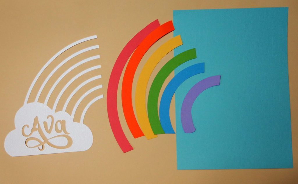 Pieces of rainbow wall art to assemble